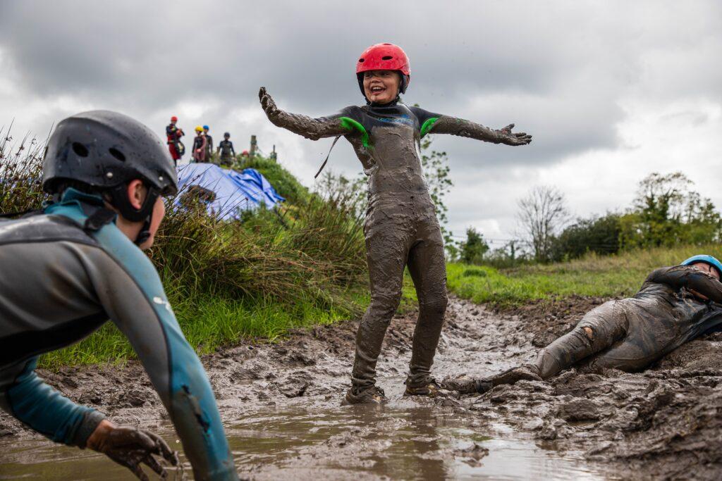 Boy on Mud Slide having fun and very muddy!